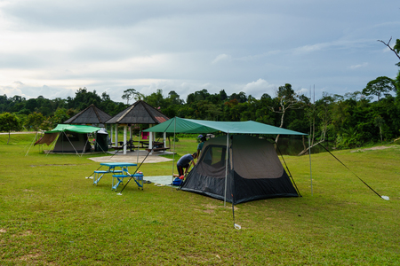 roughing: Camping tent in the forest.