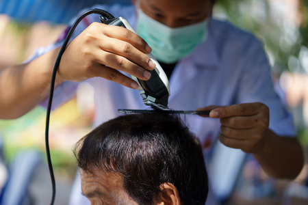 haircutting: mens haircut with clipper in the barber shop.