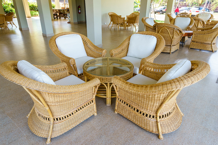antique table: Rattan table and chair in hotel.