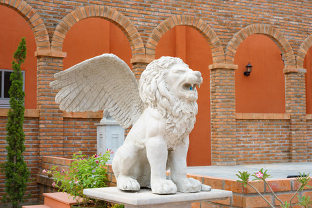 hymn: Winged Lion statue spitting water.