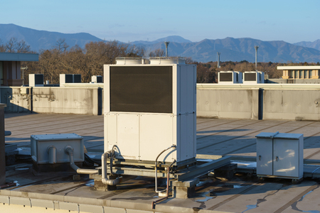 units: A row of air conditioning units on a rooftop