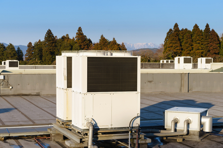 condominium complex: A row of air conditioning units on a rooftop