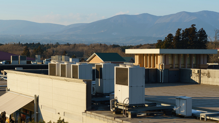 rooftop: A row of air conditioning units on a rooftop