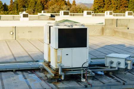 rooftop: A row of air conditioning units on a rooftop.