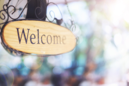 wood welcome sign hanging. selective focus. Stock Photo