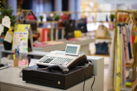 One cash register with a bar code reader in department store Imagens