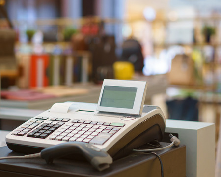 One cash register with a bar code reader in department store. Reklamní fotografie - 83536485