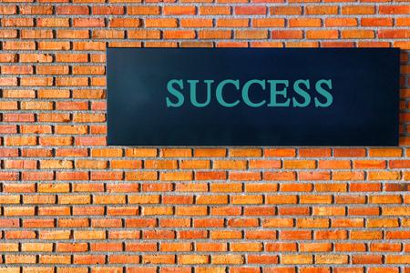 success text on brick wall Stock Photo