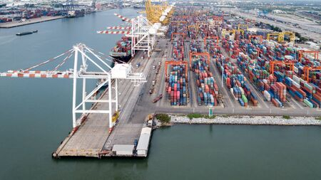 Aerial view of cargo ships loading containers at seaport