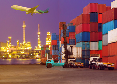 Forklift handling container box loading to truck in import export logistic zone. Standard-Bild