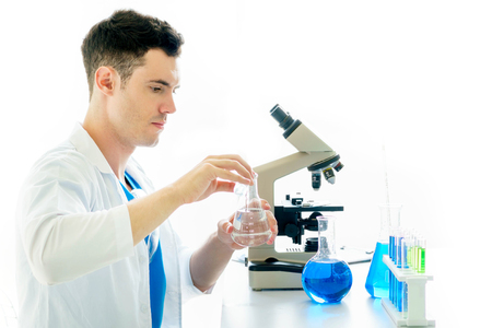 Male student of chemistry working in laboratory. Stock Photo