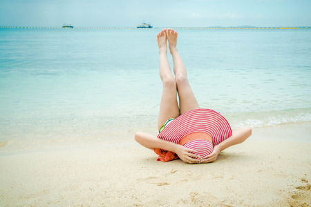 Lady sleep and relax on the beach. 写真素材