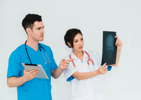 Couple doctors discussing and looking x-ray in a clinic or hospital. Stockfoto