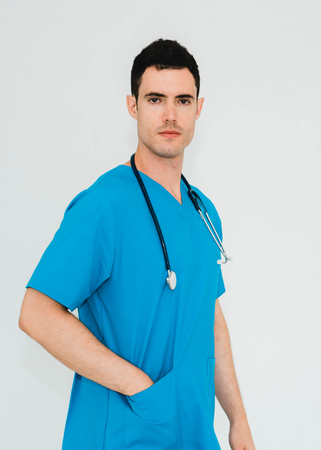 Portrait of handsome doctor standing with stethoscope. Stockfoto