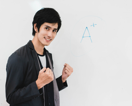 Male student standing and happiness with A-plus grade