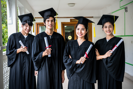 Group of multiethnic students with diplomas. Stockfoto