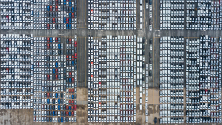 Top view of a parking lot new cars lined up in the port for import and export