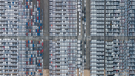 Top view of a parking lot new cars lined up in the port for import and export.