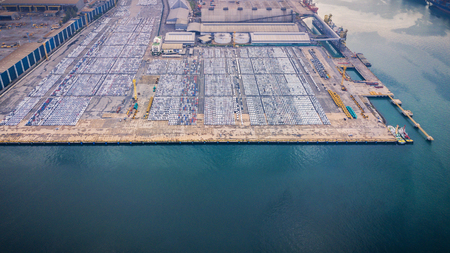 Aerial view of a parking lot new cars lined up in the port for import and export. Stock Photo