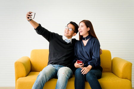 Couple taking a selfie.