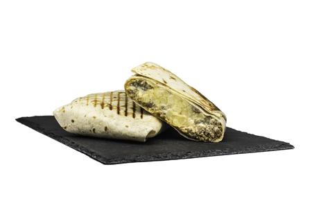 Cut single Tacos on slate white background Stock Photo