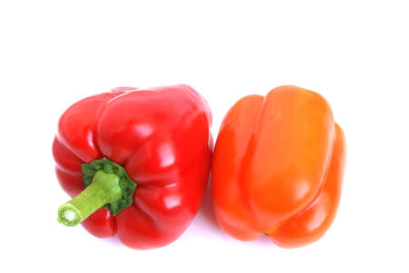 Red and orange pepper are on the white background