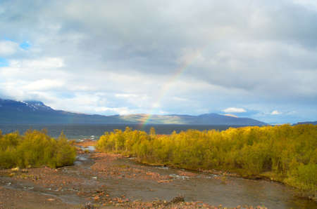 Rainbow over high-mountainous lake in the Swedish Lapland