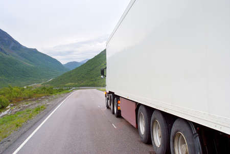 The truck on the Norwegian mountain road Stock Photo - 7361593