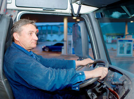 hand truck: The driver at the wheel the truck Stock Photo