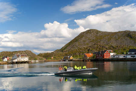 Motor boat is in a fjord of Norway photo