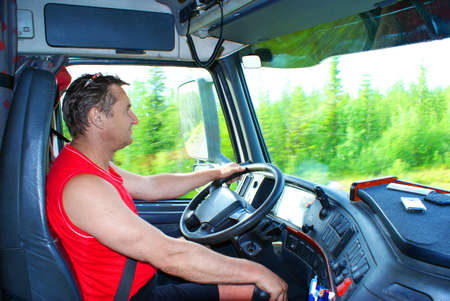 hand truck: The driver at the wheel of the truck Stock Photo