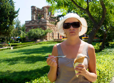 The young woman with one portion of ice-cream photo