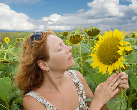 The beautiful woman in the field of sunflowers photo