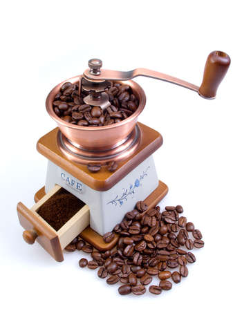 Old coffee grinder with coffee grains photo