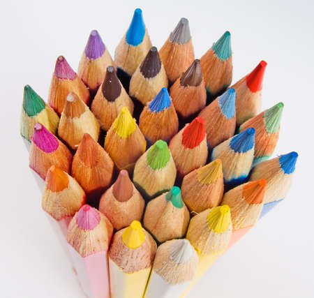 Group of colored pencils on the white background photo