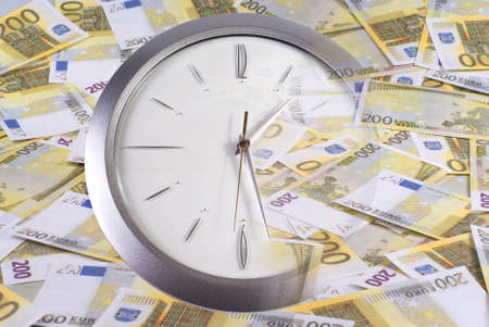 Clock and 200 euro banknotes on a white background Stock Photo - 8062656