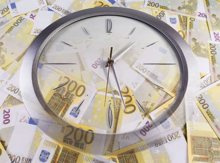 A clock and 200 euro banknotes on a white background