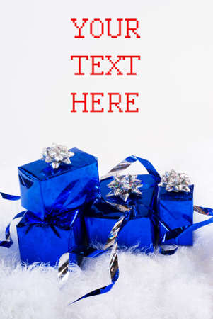 Blue shiny boxes for gifts with ribbons on the white skin photo