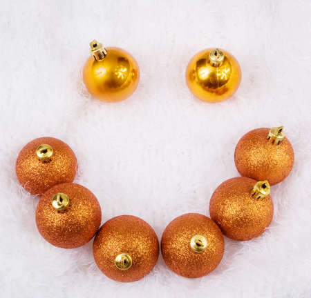 Christmas golden brightly spheres on the white fur