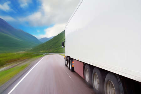 truck on highway: Motion of white semi-truck on the mountain road  Stock Photo