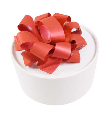 Round white gift box with a red bow Stock Photo
