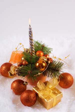 Christmas orange spheres and silver candles  photo