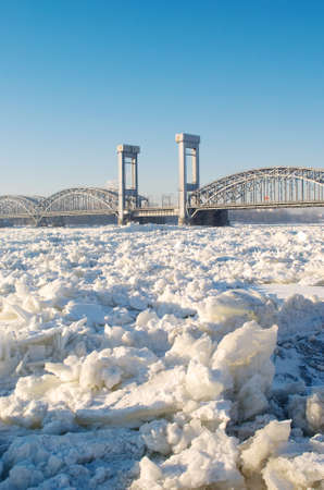 snowscape: Bridge over frozen river in sunny day Stock Photo