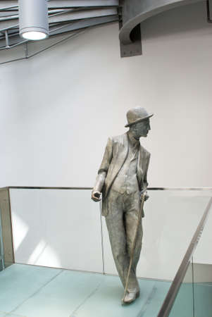 chaplin: Sculpture of man in a suit and a cane Stock Photo