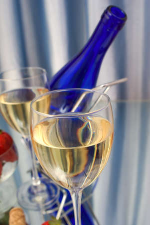 Closeup of crystal glass of white wine photo