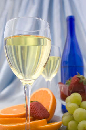 Clouseup of glass of wine with oranges and strawberry photo