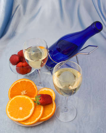 Glasses of wine with oranges and strawberry photo