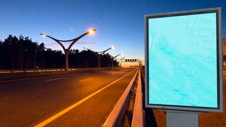 Big empty billboard on night highway photo
