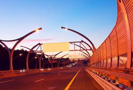 Empty billboard on night highway photo