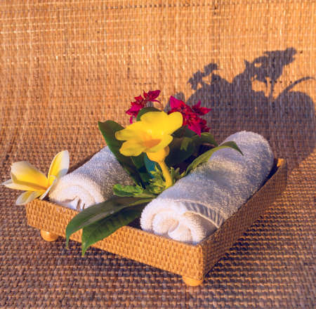 yelow: Towels with red yelow and white flowers Stock Photo
